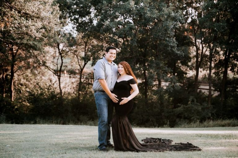 Husband touching his pregnant wife's belly